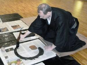 Practising Hitsuzendo (Zen-Calligraphy).